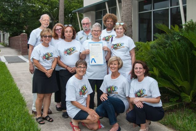 Members of Compassionate Fernandina with Proclamation of Fernandina Beach